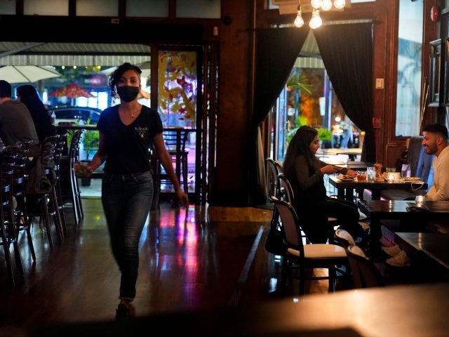 Patrons enjoy food and drink at The Brass Rail in Hoboken, N.J., Wednesday, Nov. 11, 2020. The number of confirmed COVID-19 cases surged by almost 4,000 new cases, Gov. Phil Murphy said Tuesday, the highest increase in nearly seven months. The so-called second wave led Murphy this week to announce …