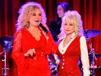 NASHVILLE, TN - APRIL 18: Stella Parton and Dolly Parton attend Stella Parton's Red Tent Women's Conference 2014 at the Doubletree Hotel Downtown on April 18, 2014 in Nashville, Tennessee. (Photo by Terry Wyatt/Getty Images)