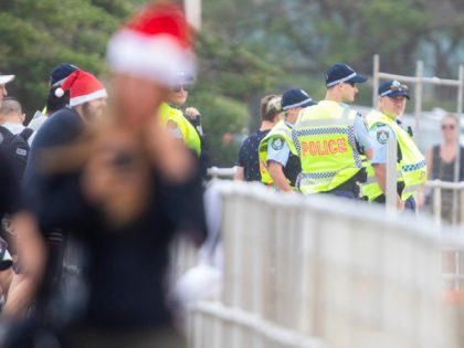 SYDNEY, AUSTRALIA - DECEMBER 25: Police officers look on at Bondi Beach on December 25, 2020 in Sydney, Australia. December is one of the hottest months of the year across Australia, with Christmas Day traditionally involving a trip to the beach and celebrations outdoors. (Photo by Jenny Evans/Getty Images)