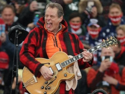 LANSING, MICHIGAN - OCTOBER 27: Entertainer and Michigan native Ted Nugent -- also known as the Motor City Madman -- performs the Star Spangled Banner during a campaign rally for U.S. President Donald Trump at Capital Region International Airport October 27, 2020 in Lansing, Michigan. With one week until Election …