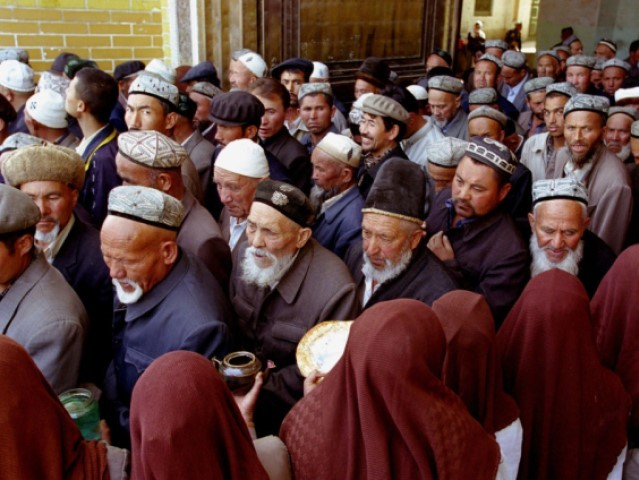 Muslim Uighur men leave after a service at the Idkah Mosque in April, 26 2002 in Kashgar, Xinjiang Region, China. China has demanded the repatriation of Uighur fighters captured alongside the Taliban in Aghanstan. China is concerned about Uighur separatist fighting for their own country in the Northwest of China …