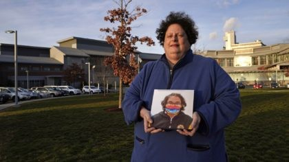Laura Dilts, of Barre, Mass., holds a photograph of her 16-year-old son outside the Worcester Recovery Center, where he is a resident patient receiving assistance for his mental health, Monday, Nov. 23, 2020, in Worcester, Mass. The coronavirus pandemic has led to rising emergency room visits and longer waits for …