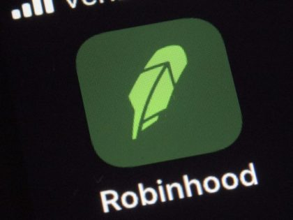This Thursday, Dec. 17, 2020 photo shows the logo for the Robinhood app on a smartphone in New York. Robinhood Financial agreed to pay $65 million to settle government charges that it failed to disclose the full details of its dealings with high-speed traders and didn't get the best prices …