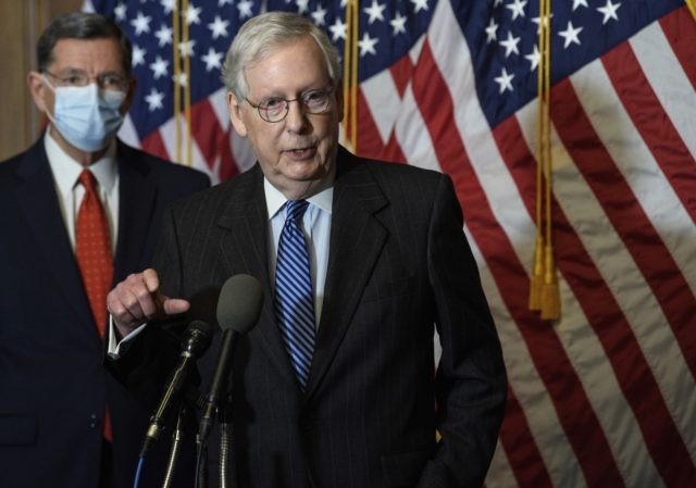 """In this Tuesday, Dec. 15, 2020, file photo, Senate Majority Leader Mitch McConnell, of Kentucky, speaks during a news conference with other Senate Republicans on Capitol Hill in Washington, while Sen. John Barrasso, R-Wyoming, listens at left. """"There will be another major rescue package for the American people,"""" McConnell said …"""