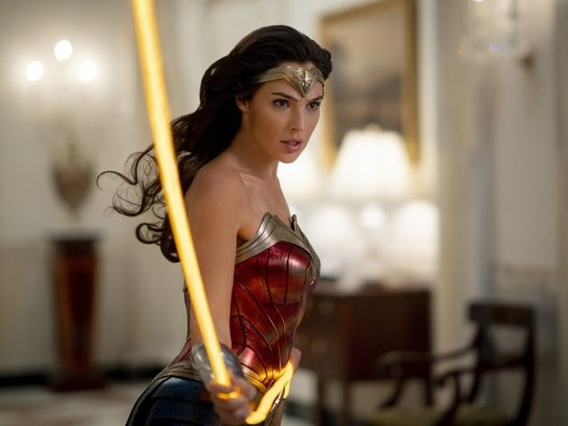 "This image released by Warner Bros. Entertainment shows Gal Gadot in a scene from ""Wonder Woman 1984."" The superhero sequel earned an estimated $38.5 million in ticket sales from international theaters, Warner Bros. said Sunday, Dec. 20, 2020. (Clay Enos/Warner Bros. via AP)"