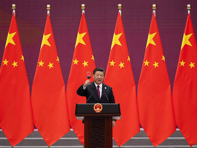 Chinese President Xi Jinping raises his glass and proposes a toast during the welcome banquet for visiting leaders attending the Belt and Road Forum at the Great Hall of the People, Friday, April 26, 2019. (Nicolas Asfouri/Pool Photo via AP)