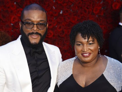 Tyler Perry, Stacey Abrams, and U.S. Rep. John Lewis, D-Ga., pose for a photo on the red carpet at the grand opening of Tyler Perry Studios, Saturday, Oct. 5, 2019, in Atlanta. (Photo by Elijah Nouvelage/Invision/AP)