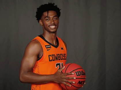 Oklahoma State guard Dee Mitchell poses for a photo during media day Tuesday, Sept. 24, 2019, in Stillwater, Okla. (AP Photo/Sue Ogrocki)