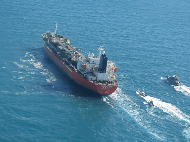 In this photo released Monday, Jan. 4, 2021, by Tasnim News Agency, a seized South Korean-flagged tanker is escorted by Iranian Revolutionary Guard boats on the Persian Gulf. Iranian state television acknowledged that Tehran seized the oil tanker in the Strait of Hormuz. The report on Monday alleged the MT …