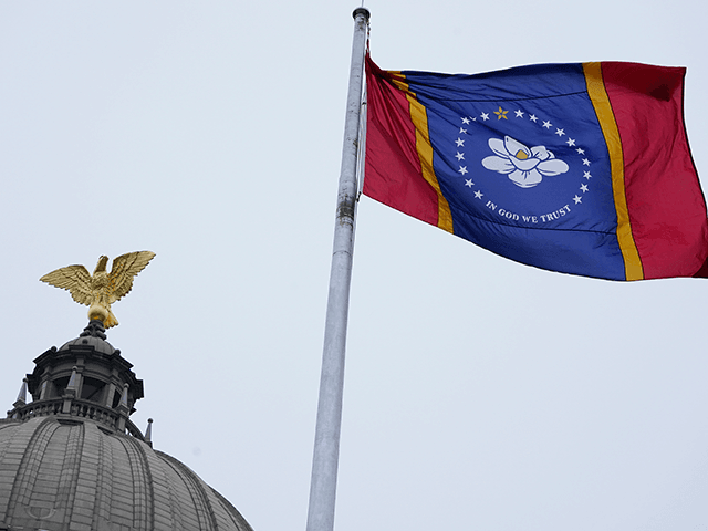 The new Mississippi state flag flies under the eagle at the top of the Capitol rotunda following the ceremonial unfurling in Jackson, Monday, Jan. 11, 2021. Earlier in the afternoon, Republican Gov. Tate Reeves signed a law that created the new state flag with magnolia at the center, six months …