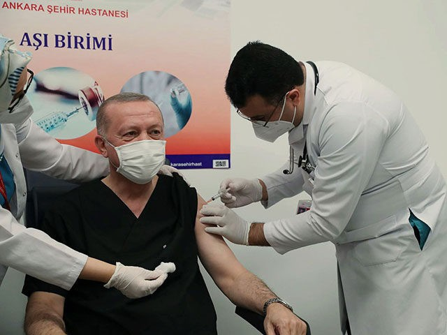 Turkey's President Recep Tayyip Erdogan receives a shot of the COVID-19 vaccination, a day after Turkish authorities gave the go-ahead for the emergency use of the COVID-19 vaccine produced by China's Sinovac Biotch Ltd., in Ankara, Turkey, Thursday, Jan. 14, 2021. Turkey became the latest country to roll out its …