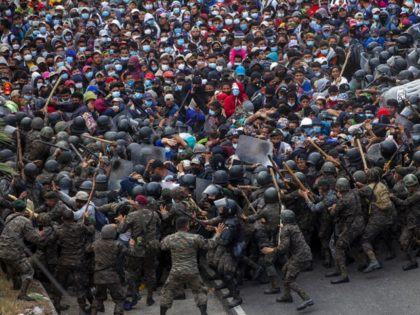 WATCH: Guatemalan Security Forces Push Migrant Caravan Back