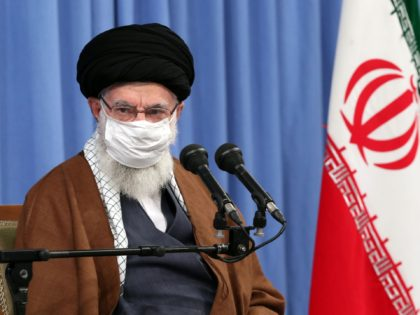 A handout picture provided by the office of Iran's Supreme Leader Ayatollah Ali Khamenei on October 24, 2020, shows him wearing a protective face mask as he gives a speech in the capital Tehran during a meeting of the national staff to discuss the issue of the novel coronavirus pandemic …