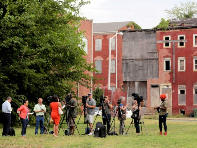 Journalists wait for a press conference with Housing and Urban Development Secretary Ben Carson to begin on a grass lot adjacent to the Morning Star Baptist Church of Christ, Wednesday, July 31, 2019, in Baltimore. Carson toured the nearby Hollins House, which has 130 one-bedroom units, and said the housing …