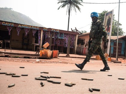"A United Nations Multidimensional Integrated Stabilization Mission in the Central African Republic (MINUSCA) soldier patrols in PK12, in front of a bar where it says ""Ambiance of PK12"", in front of heavy weapon casings, 12 kilometres from downtown Bangui, on January 13, 2021 where fighting raged against the rebels of …"