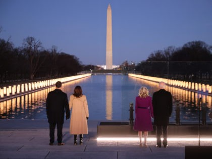 WASHINGTON, DC - JANUARY 19: (L-R) Douglas Emhoff, U.S. Vice President-elect Kamala Harris, Dr. Jill Biden and U.S. President-elect Joe Biden look down the National Mall as lamps are lit to honor the nearly 400,000 American victims of the coronavirus pandemic at the Lincoln Memorial Reflecting Pool January 19, 2021 …
