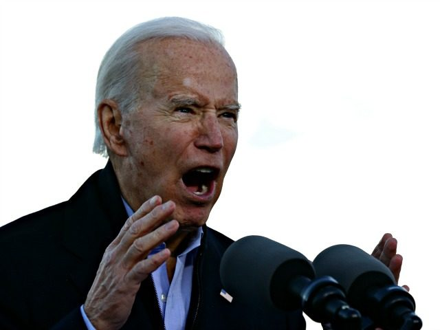 ATLANTA, GEORGIA - JANUARY 04: President-elect Joe Biden speaks as he campaigns with Democratic candidates for the U.S. Senate Jon Ossoff and Rev. Raphael Warnock the day before their runoff election in the parking lot of Centerparc Stadium January 04, 2021 in Atlanta, Georgia. Biden's trip comes a day after …