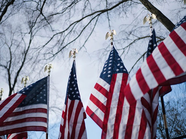 WASHINGTON, DC - JANUARY 18: U.S. flags are on display for Inauguration Day near the White House on January 18, 2021 in Washington, DC. After last week's riots at the U.S. Capitol Building, the FBI has warned of additional threats in the nation's capital and in all 50 states. According …