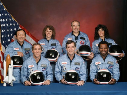 The STS-51L crewmembers are: in the back row from left to right: Mission Specialist, Ellison S. Onizuka, Teacher in Space Participant Sharon Christa McAuliffe, Payload Specialist, Greg Jarvis and Mission Specialist, Judy Resnik. In the front row from left to right: Pilot Mike Smith, Commander, Dick Scobee and Mission Specialist, …