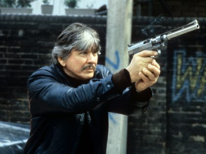 Charles Bronson aiming weapon in a scene from the film 'Death Wish 3', 1985. (Photo by Cannon/Getty Images)