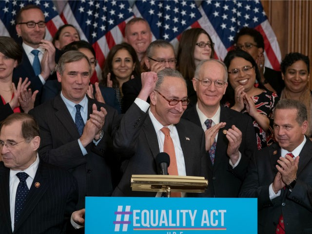 Senate Democratic Leader Chuck Schumer, D-N.Y., flanked by House Judiciary Committee Chairman Jerrold Nadler, D-N.Y., left, and Rep. David Cicilline, D-R.I., right, joins fellow Democrats in the House as they announce the introduction of The Equality Act, a comprehensive nondiscrimination bill for LGBT rights, at the Capitol in Washington, Wednesday, …