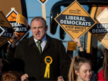 ESHER, ENGLAND - DECEMBER 11: Liberal Democrat Ed Davey meets activists during a rally on December 11, 2019 in Esher, England. Leaders of all the British political parties have entered their last day of campaigning for the general election before voters go to the polls tomorrow. (Photo by Chris J …