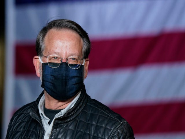 Sen. Gary Peters, D-Mich., is seen during a drive-in event where he greeted supporters and volunteers, Tuesday, Nov. 3, 2020, in Pontiac, Mich. (AP Photo/Carlos Osorio)