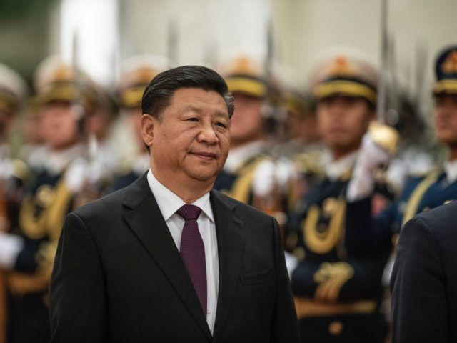 China's President Xi Jinping reviews a military honour guard during a welcome ceremony at the Great Hall of the People in Beijing on December 10, 2018. (Photo by FRED DUFOUR / AFP) (Photo credit should read FRED DUFOUR/AFP via Getty Images)