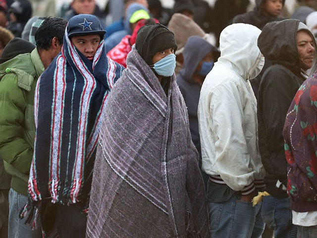 PIEDRAS NEGRAS, MEXICO - FEBRUARY 08: Migrants, most of whom are part of a recently arrived caravan, stand in line for breakfast at a migrant hostel as they wait to apply for asylum into the United States on February 07, 2019 in Piedras Negras, Mexico. The hostel is holding approximately …