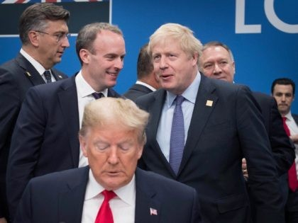 HERTFORD, ENGLAND - DECEMBER 04: US President Donald Trump (front) with Foreign Secretary Dominic Raab and British Prime Minister Boris Johnson onstage during the annual Nato heads of government summit on December 4, 2019 in Watford, England. France and the UK signed the Treaty of Dunkirk in 1947 in the …