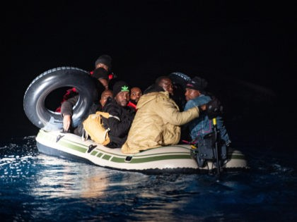 BODRUM, TURKEY - NOVEMBER 15: Migrants and refugees are seen on an inflatable boat during a rescue operation by the Turkish Coast Guard on the Aegean sea between Turkish resort town of Bodrum and the Greek island of Kos on November 15, 2019 in Bodrum, Turkey. Turkish officials reported over …