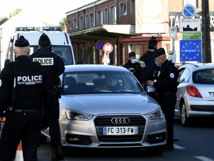 French police control drivers' statements allowing them to be out of home on November 6, 2020 at the border with Belgium in Quievrechain during a lockdown imposed by French authorities in an attempt to halt the spread of the Covid-19. (Photo by FRANCOIS LO PRESTI / AFP) (Photo by FRANCOIS …