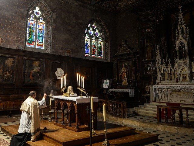 French priest Olivier Monnier prays during an afternoon Eucharistic adoration in Saint-Jacques Church in Illiers-Combray, western France, on November 15, 2020, as mass celebrations are banned as part of restrictions during France's second national lockdown aimed at curbing the spread of the Covid-19 pandemic, caused by the novel coronavirus. (Photo …