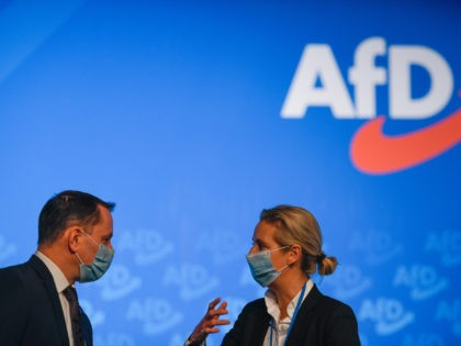 KALKAR, GERMANY - NOVEMBER 28: Alice Weidel, co-deputy federal leader and Tino Chrupalla, co-federal leader talk at the AfD party congress during the second wave of the coronavirus pandemic on November 28, 2020 in Kalkar, Germany. The AfD is holding the two-day congress with 600 expected delegates in-person, which is …