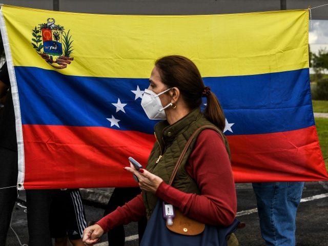 Venezuelan citizens participate in the vote for the popular consultation, as part of a protest against Venezuelan President Nicolas Maduro promoted by the Venezuelan opposition leader Juan Guaido, at Doral Central Park, in Doral, Florida on December 12, 2020. (Photo by CHANDAN KHANNA / AFP) (Photo by CHANDAN KHANNA/AFP via …
