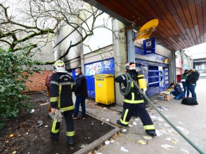 "Firemen intervene at a post office which burned on the New Year's Eve, in the working-class neighborhood of Aubiers, in Bordeaux, on January 1, 2021, where bus and streetcar stops has also been destroyed and where the forces of order wiped out ""a rain"" of fireworks mortars and projectiles the …"