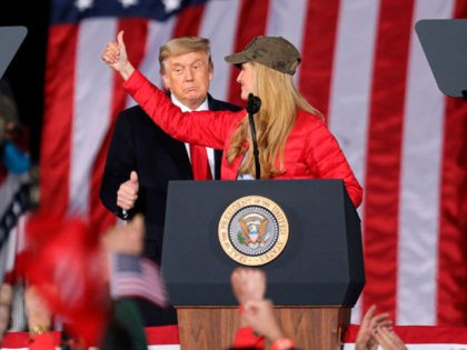 TOPSHOT - US President Donald Trump gives a thumbs up as Republican incumbent senator Kelly Loeffler speaks during a rally ahead of Senate the runoff in Dalton, Georgia on January 4, 2021. - President Donald Trump, still seeking ways to reverse his election defeat, and President-elect Joe Biden converge on …