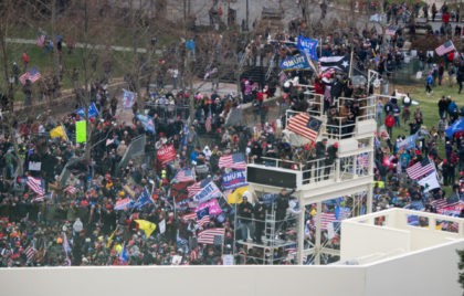 Supporters of US President Donald Trump take over stands set up for the presidential inauguration as they protest at the US Capitol in Washington, DC, January 6, 2021. - Thousands of Trump supporters, fueled by his spurious claims of voter fraud, are flooding the nation's capital protesting the expected certification …