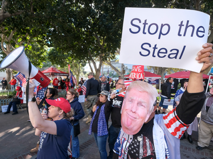 Supporters of US President Donald Trump protest in Los Angeles, California, on January 6, 2021. - Trump supporters, fueled by his spurious claims of voter fraud, are protesting the expected certification of Joe Biden's White House victory by the US Congress on January 6. (Photo by RINGO CHIU / AFP) …