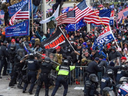 Trump supporters clash with police and security forces as they storm the US Capitol in Washington, DC on January 6, 2021. - Demonstrators breeched security and entered the Capitol as Congress debated the a 2020 presidential election Electoral Vote Certification. (Photo by ROBERTO SCHMIDT / AFP) (Photo by ROBERTO SCHMIDT/AFP …