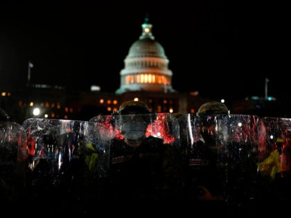 Members of the DC National Guard are deployed outside of the US Capitol in Washington DC on January 6, 2021. - Donald Trump's supporters stormed a session of Congress held today, January 6, to certify Joe Biden's election win, triggering unprecedented chaos and violence at the heart of American democracy …
