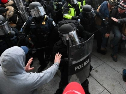 Riot police push back a crowd of supporters of US President Donald Trump after they stormed the Capitol building on January 6, 2021 in Washington, DC. - Donald Trump's supporters stormed a session of Congress held today, January 6, to certify Joe Biden's election win, triggering unprecedented chaos and violence …
