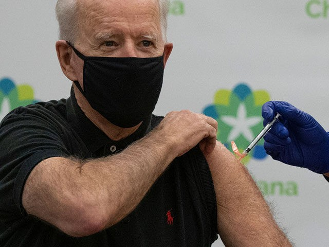 US President-elect Joe Biden receives the second course of the Pfizer-BioNTech Covid-19 vaccine on January 11, 2021 at Christiana Hospital in Newark, Delaware, administered by Chief Nurse Executive Ric Cuming. (Photo by JIM WATSON / AFP) (Photo by JIM WATSON/AFP via Getty Images)
