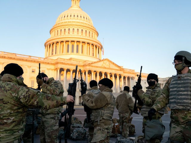 Weapons are distributed to members of the National Guard outside the U.S. Capitol on January 13, 2021 in Washington, DC. (Photo by Stefani Reynolds/Getty Images)
