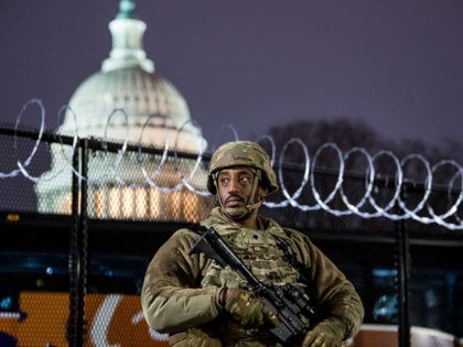 WASHINGTON, DC - JANUARY 15: VA National Guard stands outside the razor wire fencing that surrounds the US Capitol on January 15, 2021 in Washington, DC. After last week's Capitol Riot the FBI has warned of additional threats against the US Capitol and in all 50 states. According to reports, …