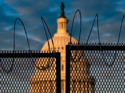 WASHINGTON, DC - JANUARY 16: The U.S. Capitol is seen behind a fence with razor wire during sunrise on January 16, 2021 in Washington, DC. After last week's riots at the U.S. Capitol Building, the FBI has warned of additional threats in the nation's capital and in all 50 states. …