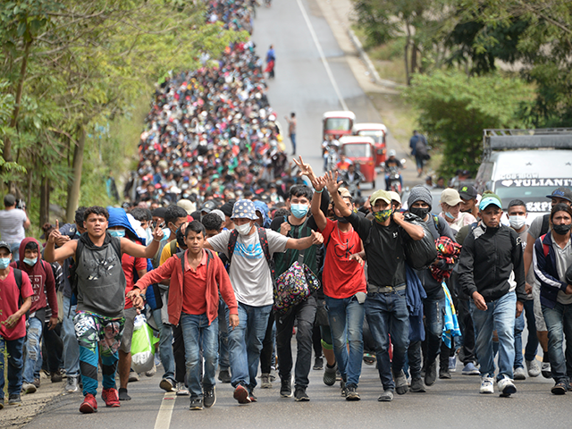 Honduran migrants, part of a caravan heading to the United States, walk along a road in Camotan, Guatemala on January 16, 2021. - At least 4,500 Honduran migrants pushed past police and crossed into Guatemala Friday night, passing the first hurdle of a journey north they hope will take them …