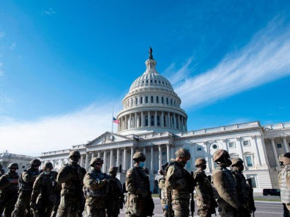 "Members of the US National Guard arrive as the US Capitol goes into lockdown after an ""external security threat"" prior to a dress rehearsal for the 59th inaugural ceremony for President-elect Joe Biden and Vice President-elect Kamala Harris at the US Capitol on January 18, 2021 in Washington, DC. - …"