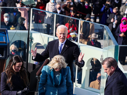 US President Joe Biden reacts as he prepares to deliver his inaugural address during his inauguration on the West Front of the US Capitol on January 20, 2021 in Washington, DC. - During today's inauguration ceremony Joe Biden becomes the 46th president of the United States. (Photo by Tasos Katopodis …