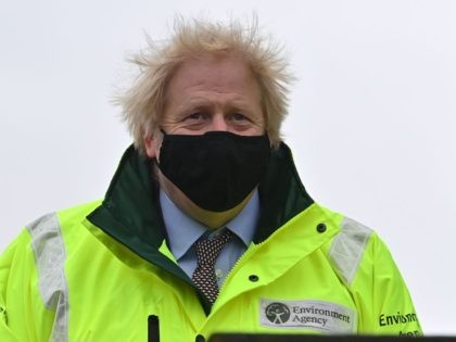 Britain's Prime Minister Boris Johnson reacts as during his visit to a storm basin near the River Mersey in Didsbury, Manchester, northwest England as Storm Christoph brings heavy rains across the country on January 21, 2021. (Photo by Paul ELLIS / POOL / AFP) (Photo by PAUL ELLIS/POOL/AFP via Getty …